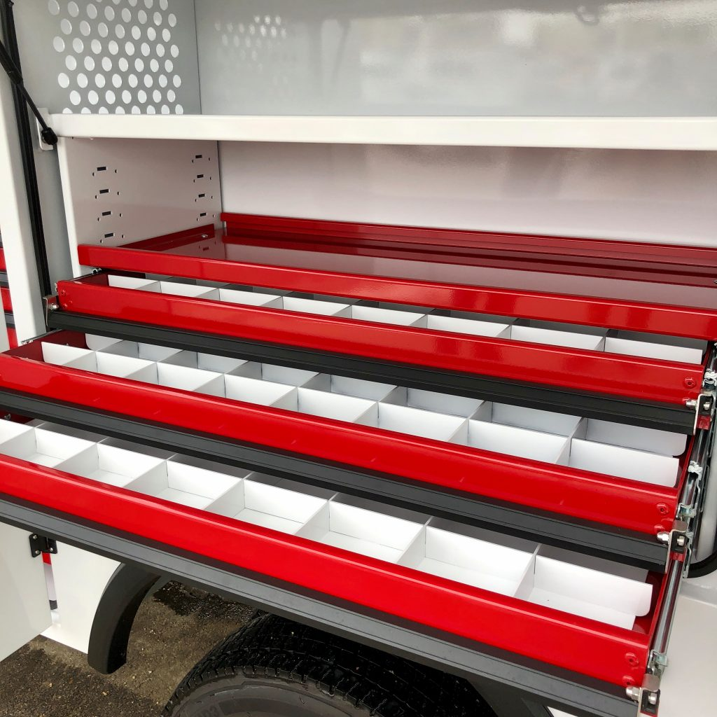 custom 2020 Ford F-550 crane truck red drawers being pulled out