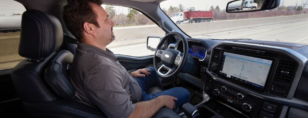 a man using hands-free driving technology