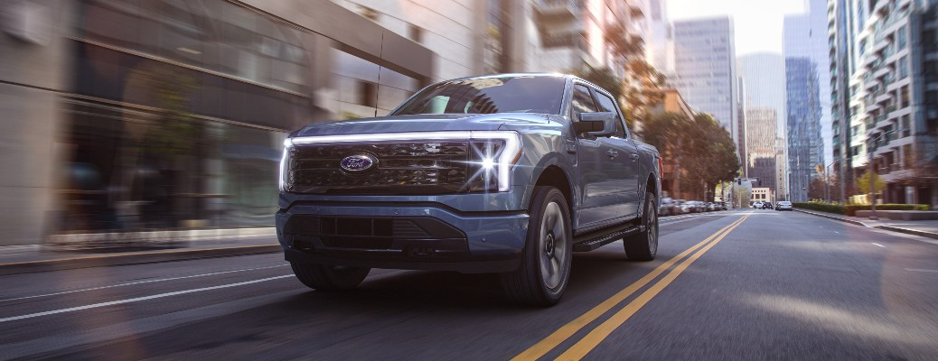 2022 Ford F-150 Lightning truck on a road in a city