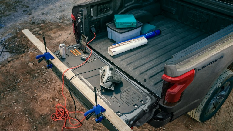 2022 Ford F-150 Lightning with tools in its bed