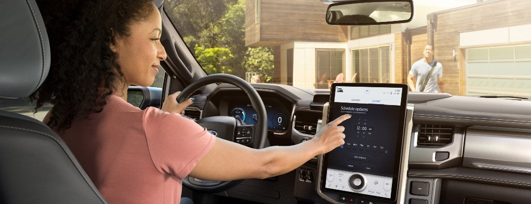 2022 Ford F-150 Lightning with a woman in the driver's seat