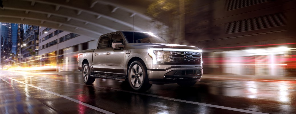 2022 Ford F-150 Lightning truck in the dark with lights on