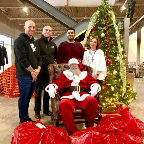 Volunteers at Sherwood Ford gathered around gift bags and hampers