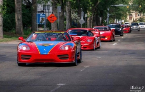 Three red models in Racing For A Cure Parade