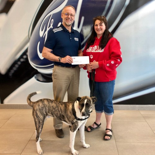 David from Sherwood Ford presenting check to SCARS representative