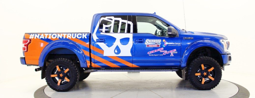 Profile view of Sherwood Ford NATIONTRUCK with Chase The Cure YEG logos affixed
