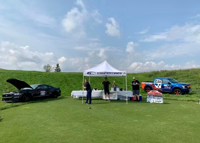 People teeing off at Mark Spector Golf Classic