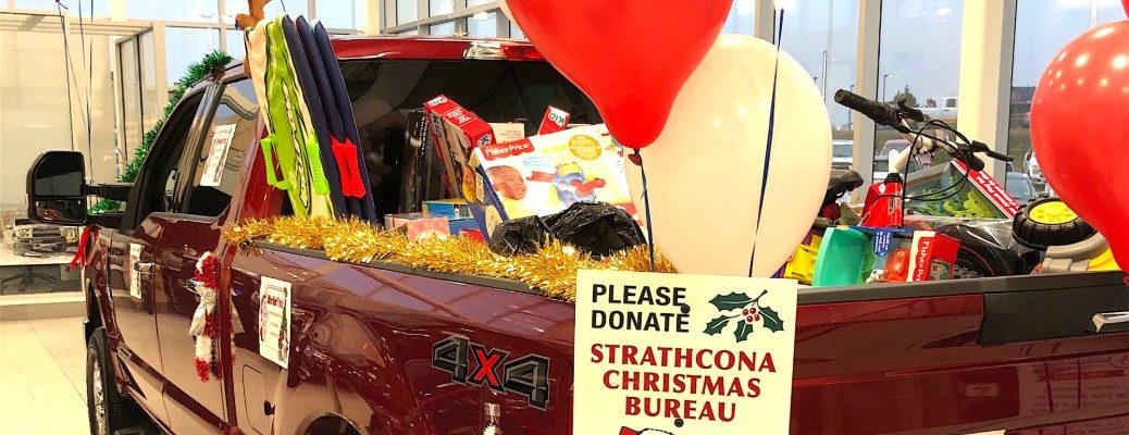 Presents and donation sign in Sherwood Ford Giant Truck