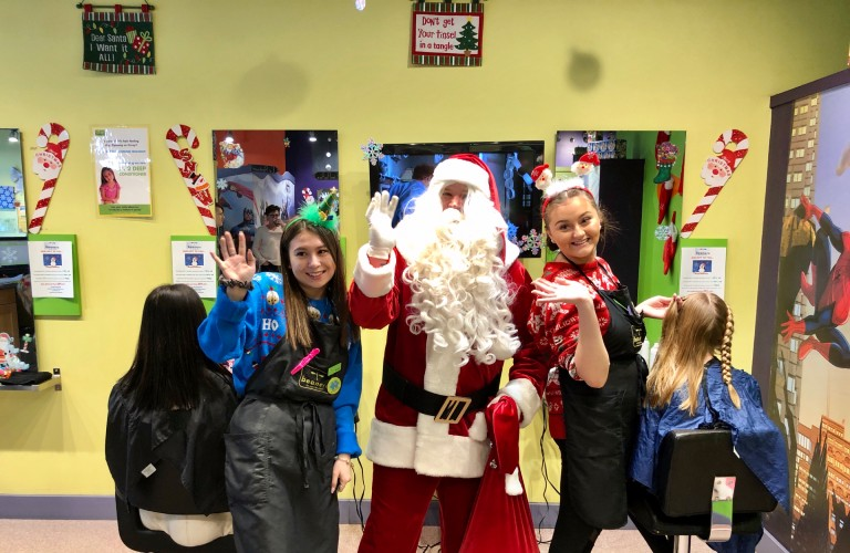 Sherwood Ford's Santa Claus with kids at Beaner's Fun Cuts