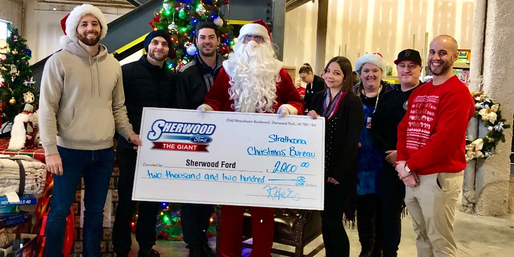 Members of Sherwood Ford holding donation check for Strathcona County Christmas Bureau