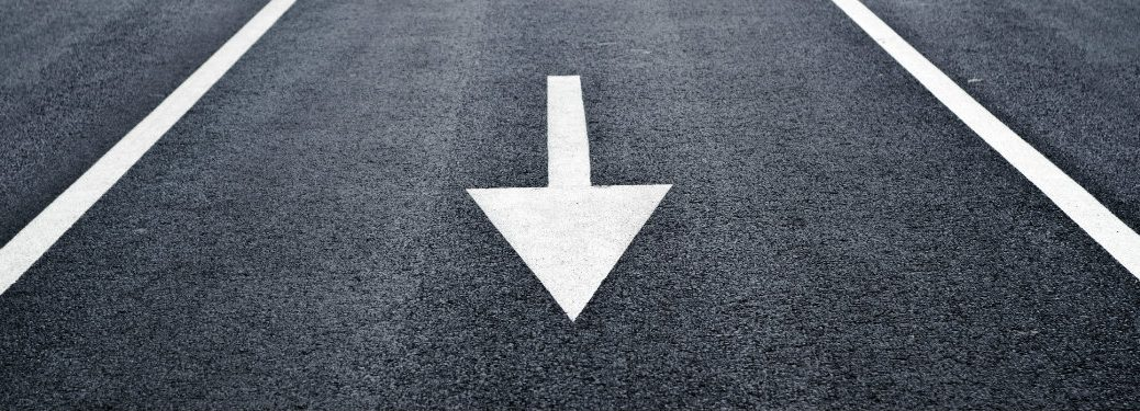 giant-white-arrow-between-two-white-lines-on-the-road