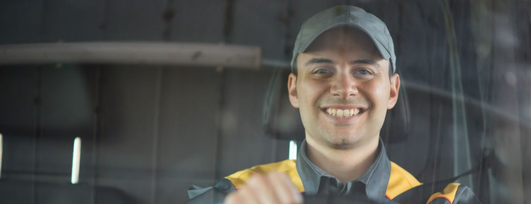 A stock photo of a person behind the wheel of a truck.