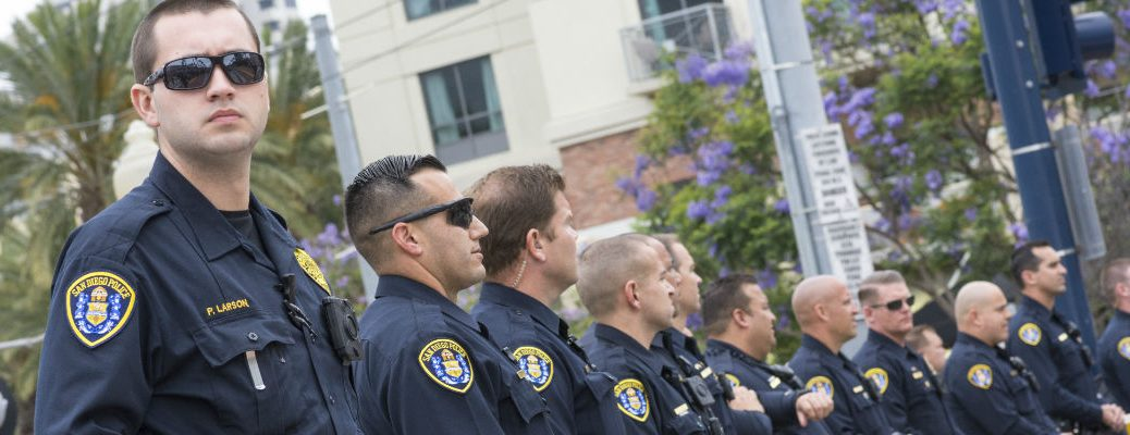 A stock photo of police officers standing in a line.