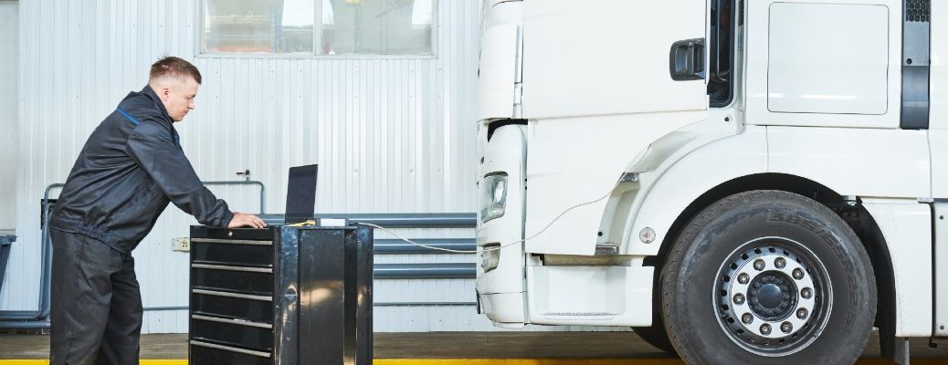 A stock photo of a technician working on a semi.