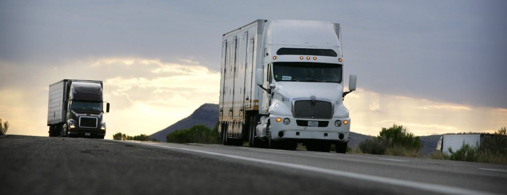 A stock photo of tractor-trailers on the road.