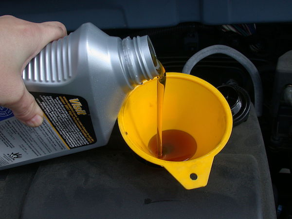 refilling motor oil as part of oil change