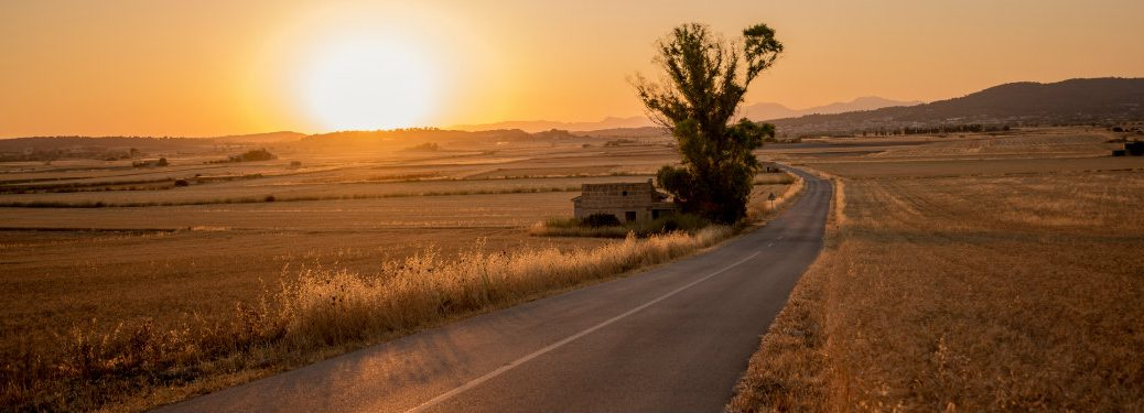 Sunset over a rural road