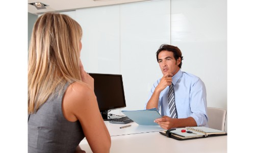 Salesman with woman in his office