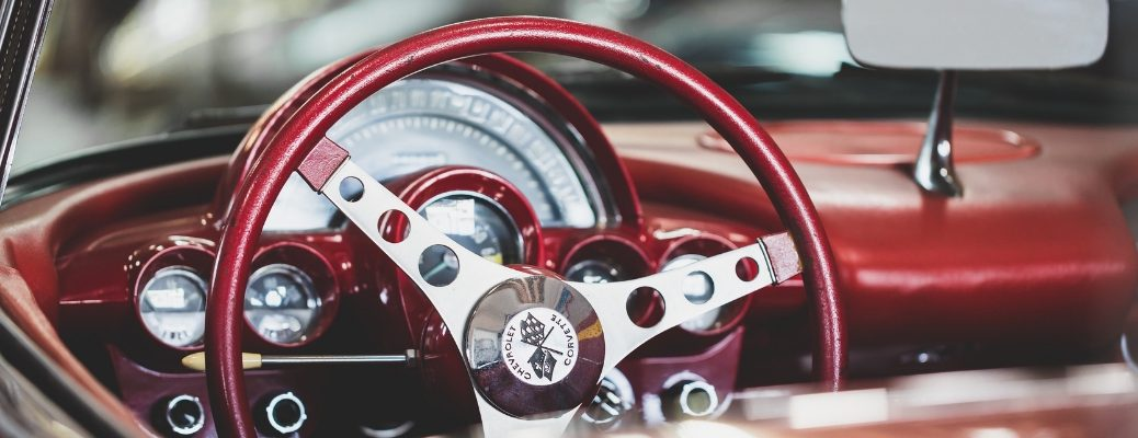 Vintage red steering wheel in Chevrolet Corvette