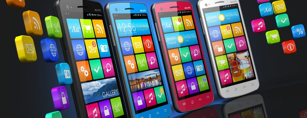 Four smartphones with multi-colored apps on the screens