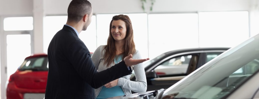 Man Selling car to woman
