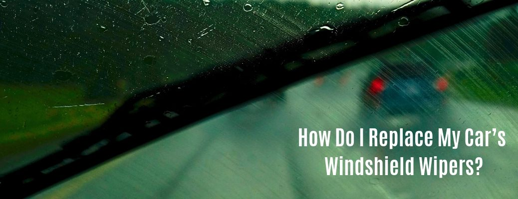 "Dirty windshield with ""How Do I Replace My Car's Windshield Wipers?"" white text in lower right corner"
