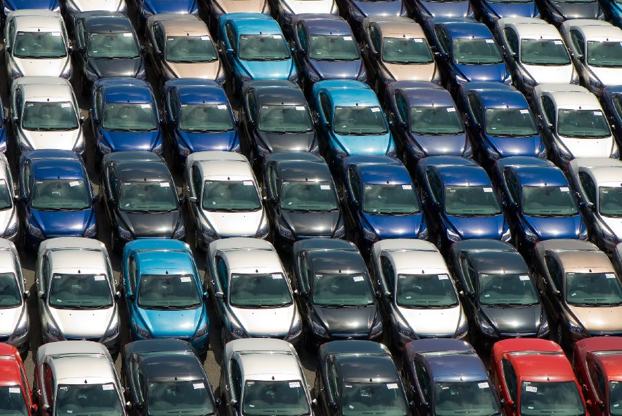 different colored cars in a car lot