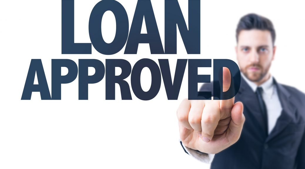 Man pointing at text Loan Approved