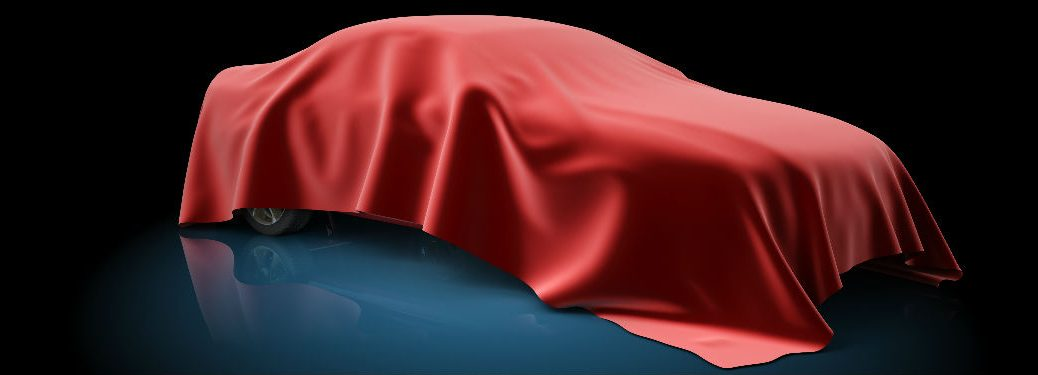 Car covered with red sheet