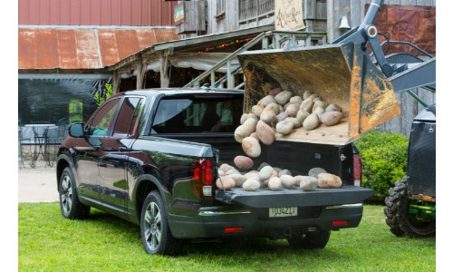2019 Honda Ridgeline truck bed being loaded