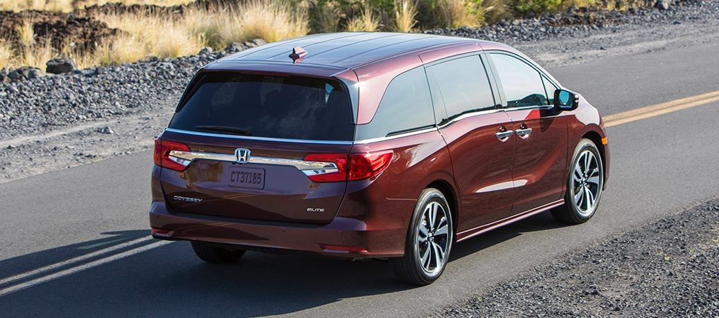 the 2019 honda odyssey driving away