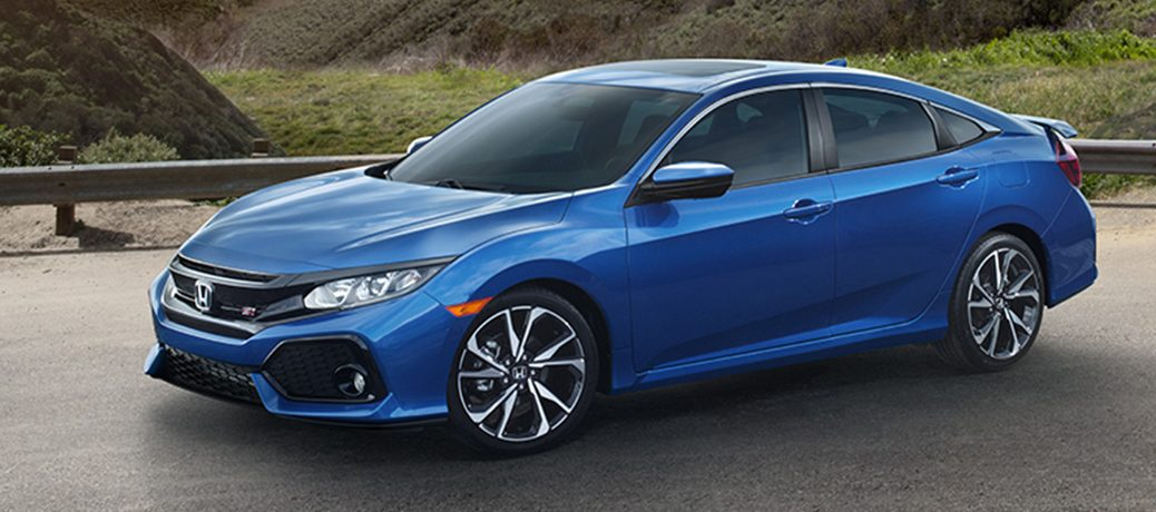 blue honda civic si with a moonroof