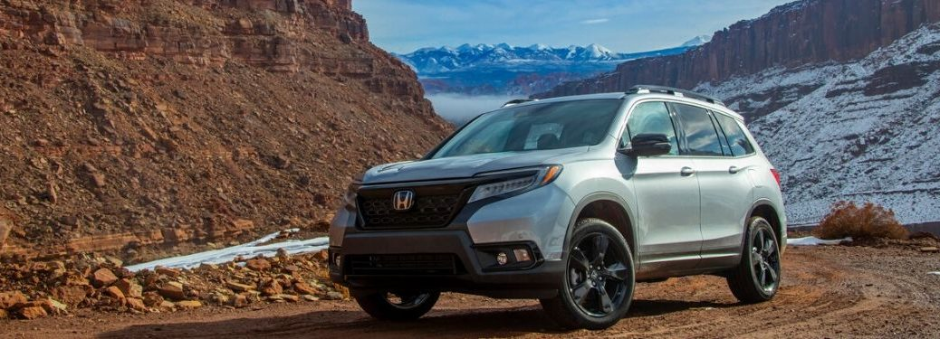 2020 Honda Passport in front of snow and mountains
