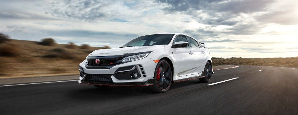 2020 Honda Civic Type R white driving around curve of desert road