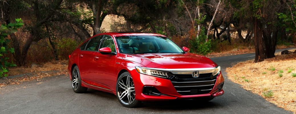 2021 Honda Accord Hybrid red parked on road at angle