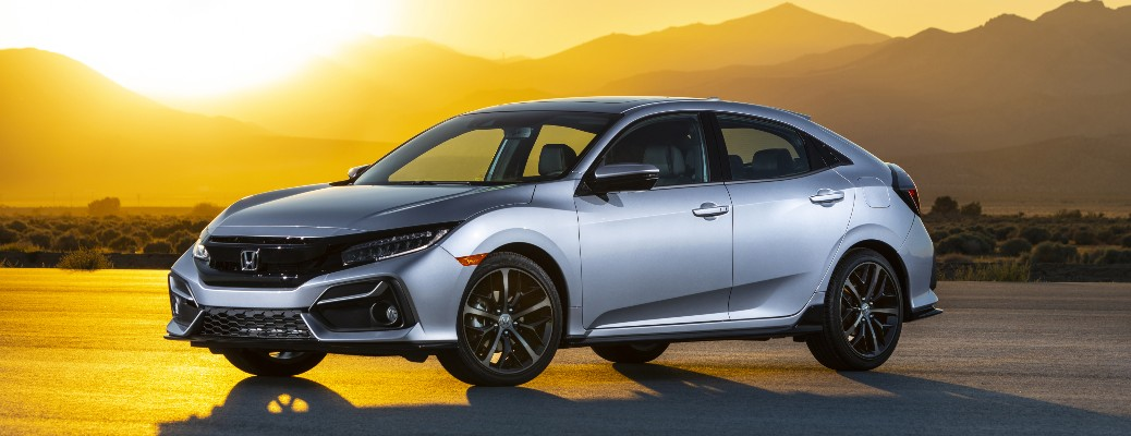 2021 Honda Civic Hatchback Sport Touring silver parked in front of sunset