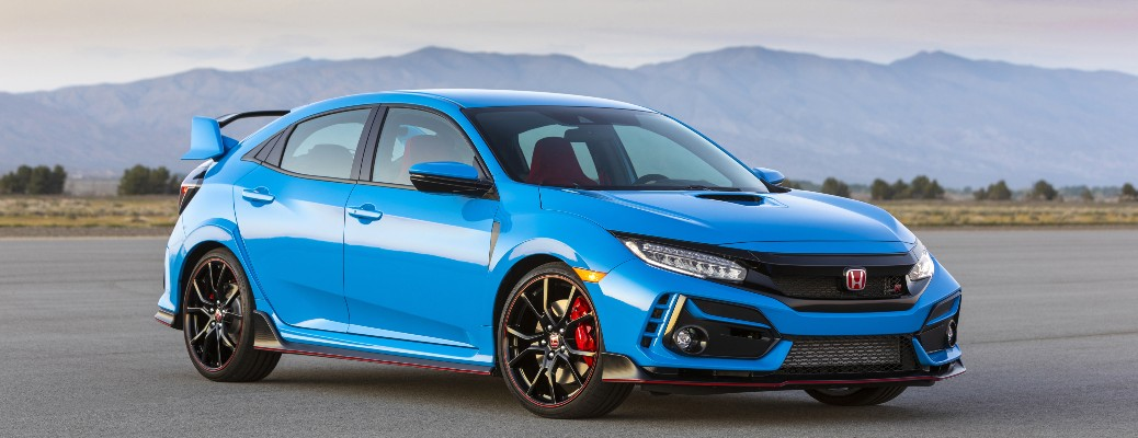 2021 Honda Civic Type R blue parked with mountain background
