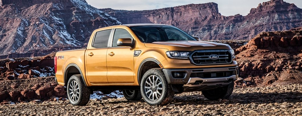 Exterior view of a gold 2019 Ford Ranger parked in rocky terrain