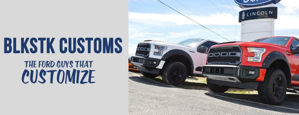 """BLKSTK Customs The Ford Guys That Customize"" header with image of two trucks with Dakar package"