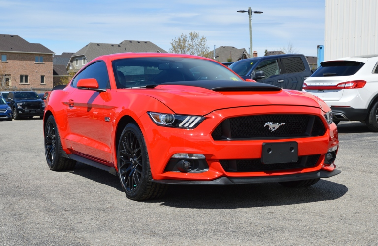Exterior view of a red Ford Mustang with Mustang Venom Package