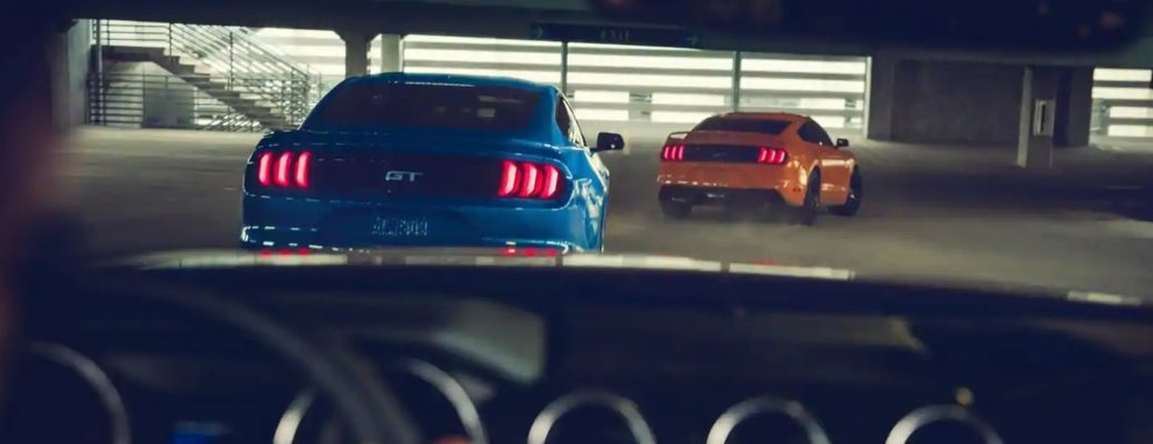A 2019 Ford Mustang Driver's view of a race with two other 2019 Ford Mustang models