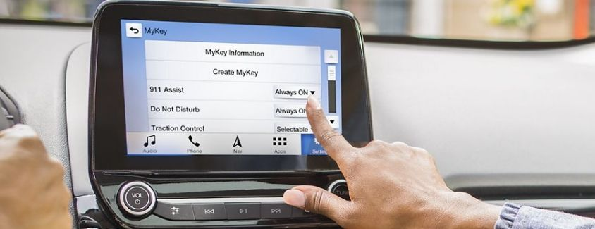 Image of a passenger exploring Ford MyKey® on the center touchscreen display