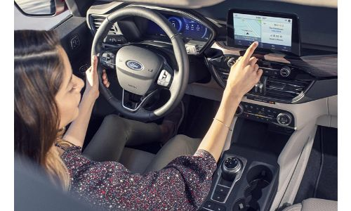 2020 Ford Escape interior with a driver in the seat
