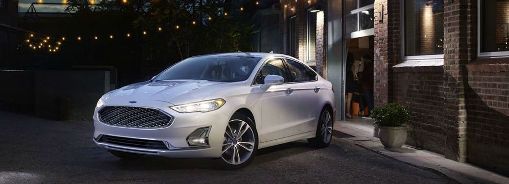 2020 Ford Fusion white exterior front fascia driver side parked night time