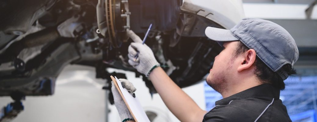 A stock photo of a person working on a vehicle.
