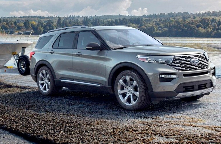 A gray 2020 Ford Explorer hauling a boat.