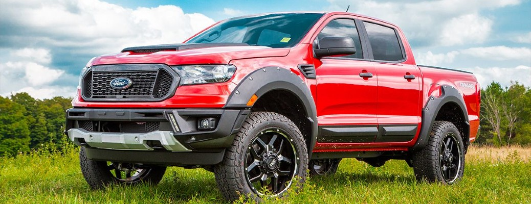 A red 2019 Ford Ranger Dakar Edition, customized by BLKSTK Customs.