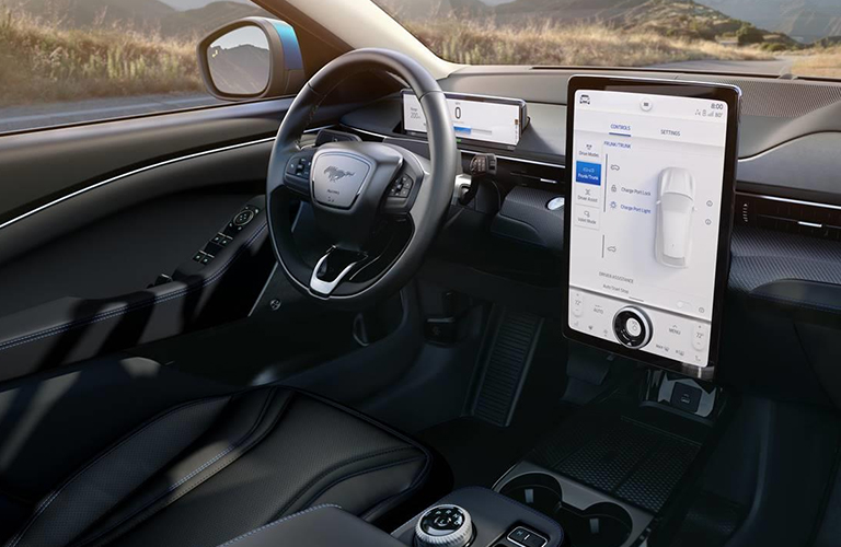 The front interior view inside the 2021 Ford Mustang Mach-E and its portrait-style infotainment screen with SYNC® 4 technology.