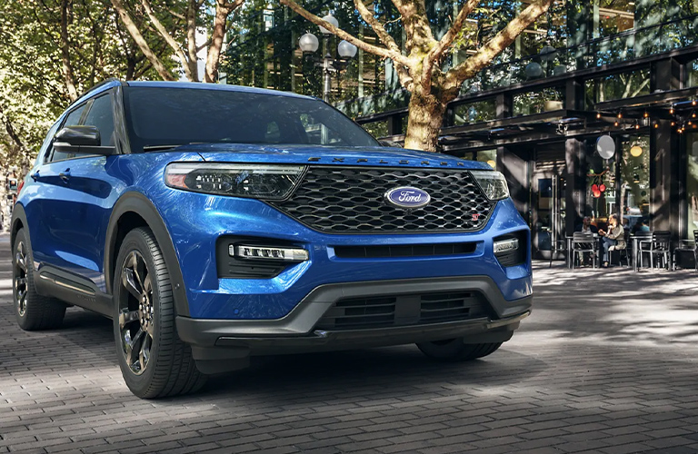 The front side of a blue 2021 Ford Explorer.
