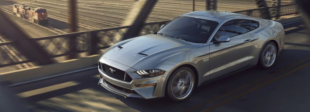2021 Ford Mustang driving down a bridge